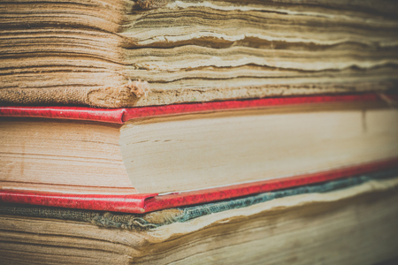 Ancient books. A bunch of old books. Books in the old cover close up 免版税图像