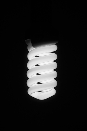 A brightly lit lamp. Low-power electric bulb.