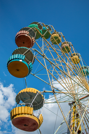 Old fashioned ferris wheel. Rusty ferris wheel. Panoramic wheel. Old carousel in an undeveloped country. Not a safe attraction.