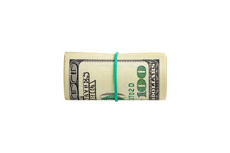 Money in a roll tied with an elastic band. The isolated object on a white background. Close up photo of money. U.S. dollars. Banknotes. Paper money isolated on white background.
