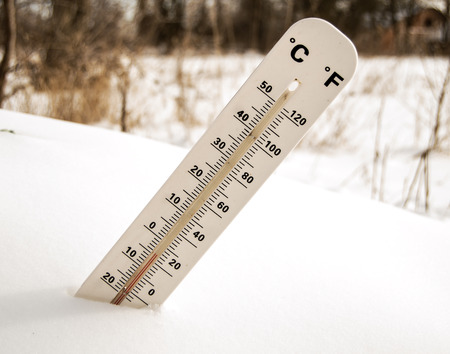 extreme weather:  Thermometer in the snow Stock Photo