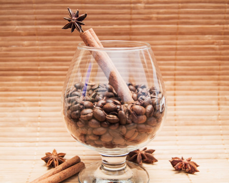 Coffee beans in a glass photo