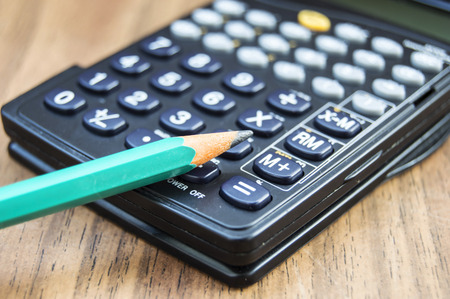 Calculator and pencil Stock Photo