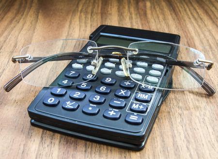 Calculator and glasses Stock Photo