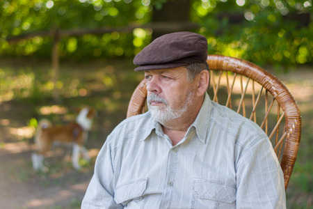 Outdoor portrait of senior bearded in a park