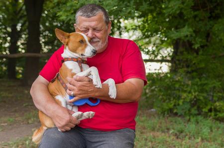 old man beard: Bearded senior man with his lovely basenji dog