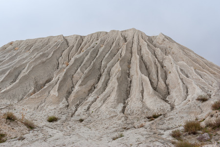macadam: Mountain made from macadam and sand in open-pit mining for rock