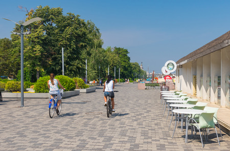dnepr: Dnepropetrovsk, Ukraine - August 15, 2015: People in the city cycling along Dnepr river embankment at summer season