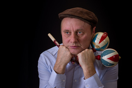 woodwind: Portrait of mature musician with Ukrainian woodwind instrument sopilka and maracas Stock Photo
