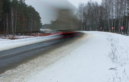 speedy: Motion blur of a speedy truck on winter road