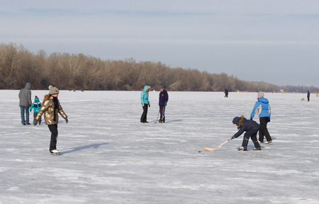 dnepr: Dnepropetrovsk, Ukraine - January 26, 2014: People in the city use frozen river Dnepr for to go in for skating