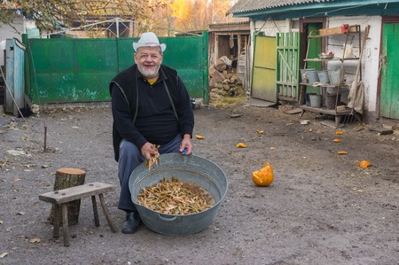 Happy Ukrainian peasant with haricot harvest at the homestead