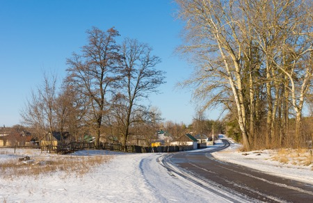 clody sky: Winter landscape with road to Derevki village in central Ukrainian