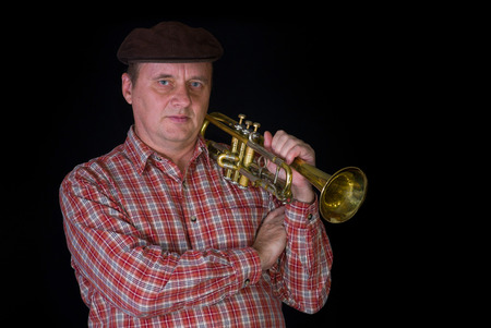 aerophone: Portrait of mature trumpeter with the instrument