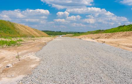 macadam: Macadam layer on an unfinished highway near Dnepropetrovsk city in Ukraine