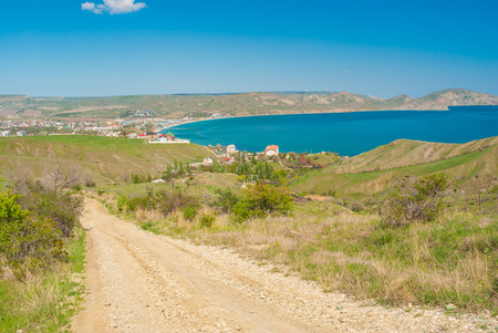 earth road: Earth road leading from Kara-dag natural reserve to settlement Kotebel on a Black Sea shore in Eastern Crimea Stock Photo