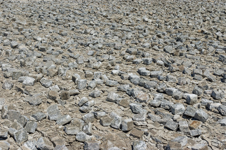 dismantled: Industrial background - dismantled cobblestone pavement