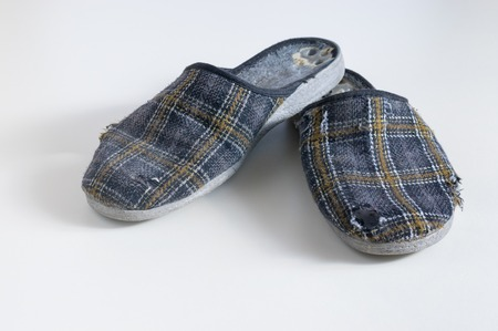 needless: Old worn Low-heeled slippers slippers on a bright background