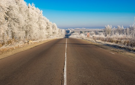 hoar frost: Morning landscape with high-way near leading to Trostianets city in Ukraine. Its hoar frost weather at fall season.
