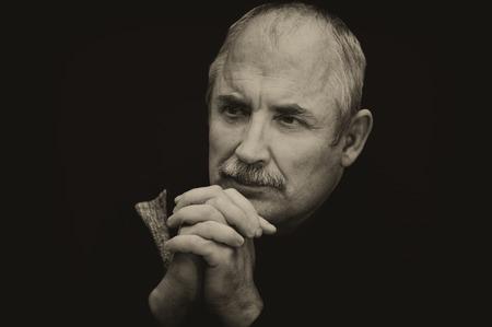 composure: Sepia toned image of a thoughtful Caucasian man