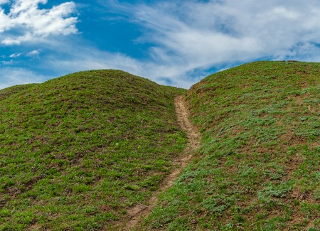inclination: Foot-path in hilly place at spring season