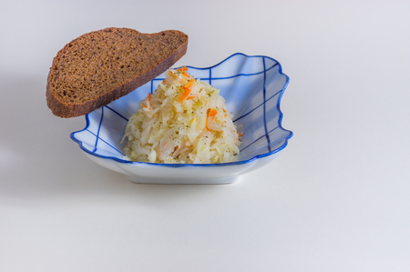 especially: Sauerkraut with slice of rye bread - traditional Russian meal (especially at winter time) Stock Photo