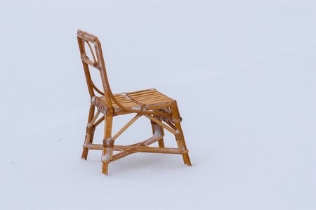 debility: Handmade wicker chair for kids in the snow Stock Photo