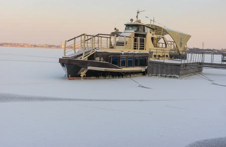 dnepr: Pleasure boat frozen in on a Dnepr river in center of Dnepropetrovsk city Stock Photo