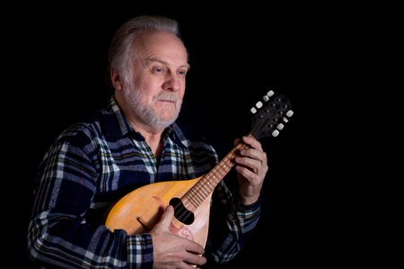 mandolin: Portrait of bearded senior man with mandolin
