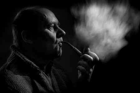 eloquent: Black and white portrait of a caucasian man smoking tobacco pipe