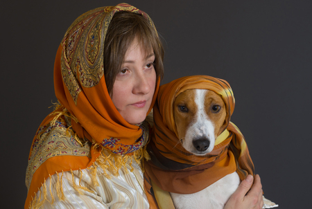 trustful: Portrait of beautiful woman with basenji dog - both wearing shawls