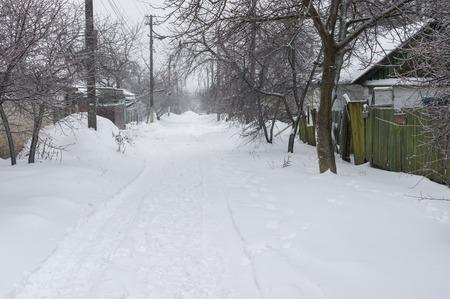 garden settlement: Snowy street of a small Ukrainian village at winter season