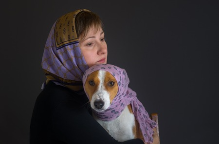 trustful: Portrait of beautiful woman with basenji dog wearing shawls