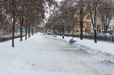 workday: Dnepropetrovsk, Ukraine - January 19, 2016: Karl Marx avenue of the Dnepropetrovsk city covered by ice and snow at workday at winter season