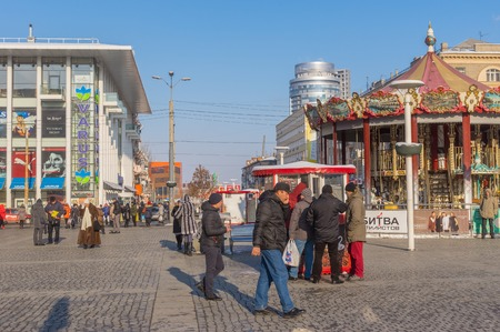workday: Dnepropetrovsk, Ukraine - January 19, 2016: Central  square of the Dnepropetrovsk city with many people at workday