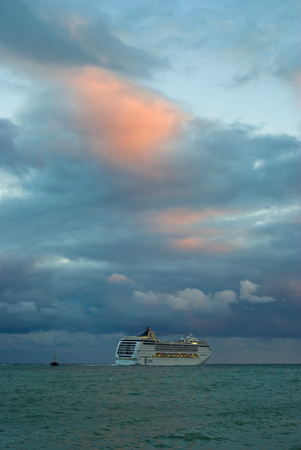 oceanic: Yalta, Ukraine - October 06, 2010: Big oceanic ship sailing off from Yalta port at fall evening
