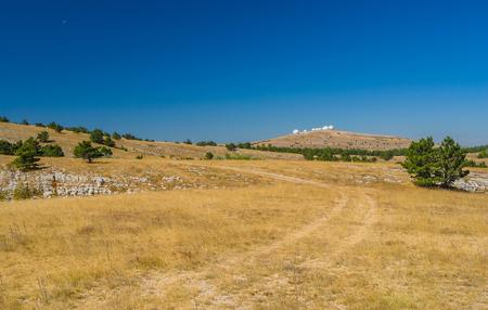Sunny autumanl landscape on Ai-Petri mountain tableland in Crimean peninsula