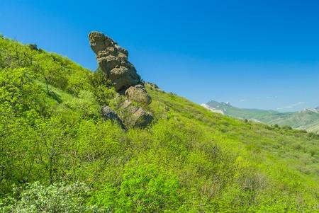 disorderly: Disorderly lying rocks on slopes of ancient volcanic mountain range Kara Dag, Eastern Crimea Stock Photo