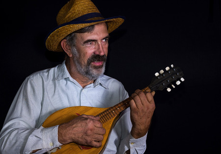 mandolin: Portrait (low key) of an old country man with mandolin Stock Photo