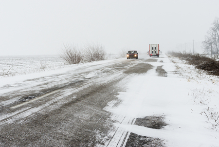 driving conditions: Winter landscape with highway and snow-drift in central Ukraine