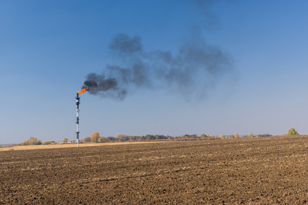 oilwell: Ukrainian landscape with pipe of burning oil-well gas