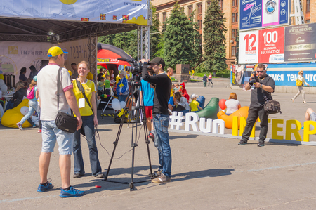 dnepr: DNEPR, UKRAINE - MAY 22, 2016:Interview on a central square of the city during Interipe  Dnipro Half Marathon race on the city street at May 21, 2016 in Dnepr, Ukraine