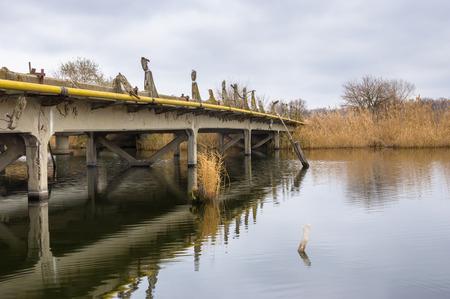 rushy: Old ruined bridge over small river