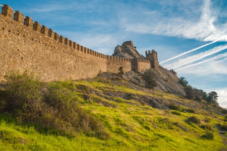 sudak: Spring landscape with ancient wall of Genoese fortress in Sudak, Crimea, Ukraine Stock Photo