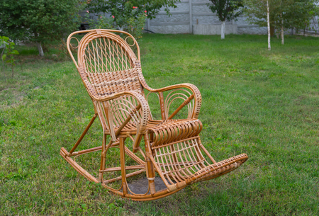 debility: Wicker rocking-chair in the garden