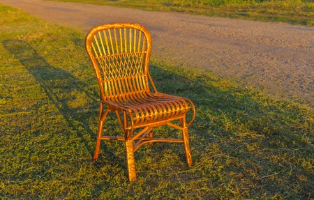 holidaymaker: Wicker chair is waiting for the holiday-maker