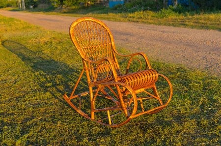 holidaymaker: Wicker rocking-chair is waiting for the holiday-maker Stock Photo