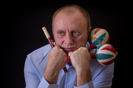 woodwind: Portrait of sad musician with Ukrainian woodwind instrument sopilka and maracas Stock Photo