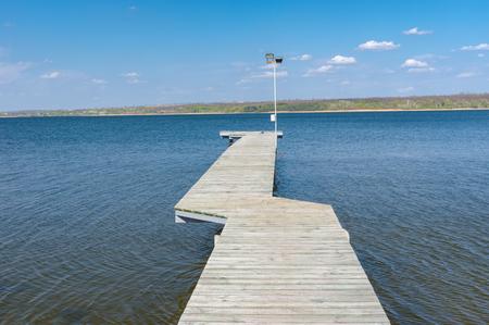 dnepr: Empty wooden pier on Dnepr river in Ukraine Stock Photo