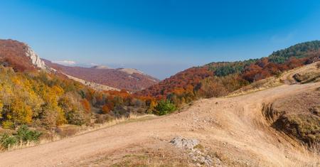 earth road: Autumnal landscape with earth road in mountain pasture Demerdzhi, Crimean peninsula